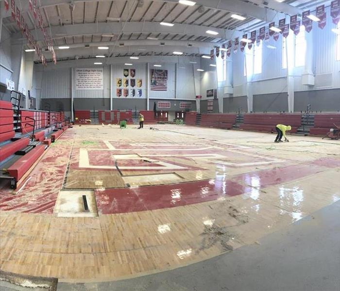 Olivet College Cutler Event Center Gymnasium - begining stages of tear out on Gym floor