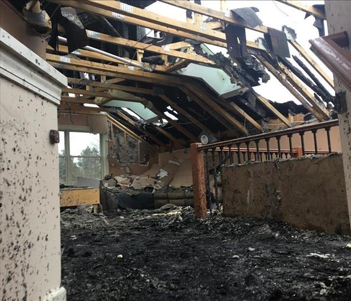 Exposed rafters in burned and blacked house