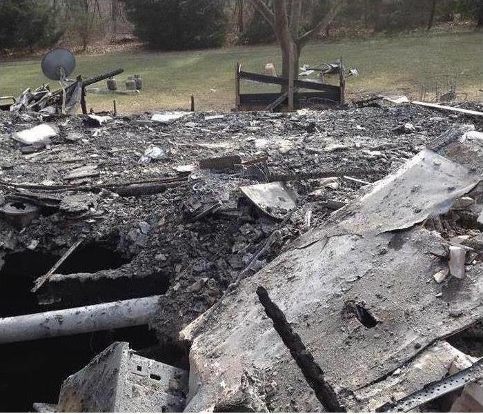 A total loss fire damaged home in Eaton County